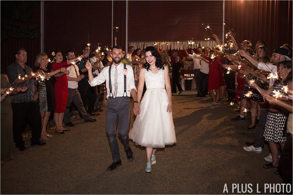 Colorful Rockabilly Wedding - Wedding Wedding Sparkler Exit - Heart of Rock - A Plus L Photo