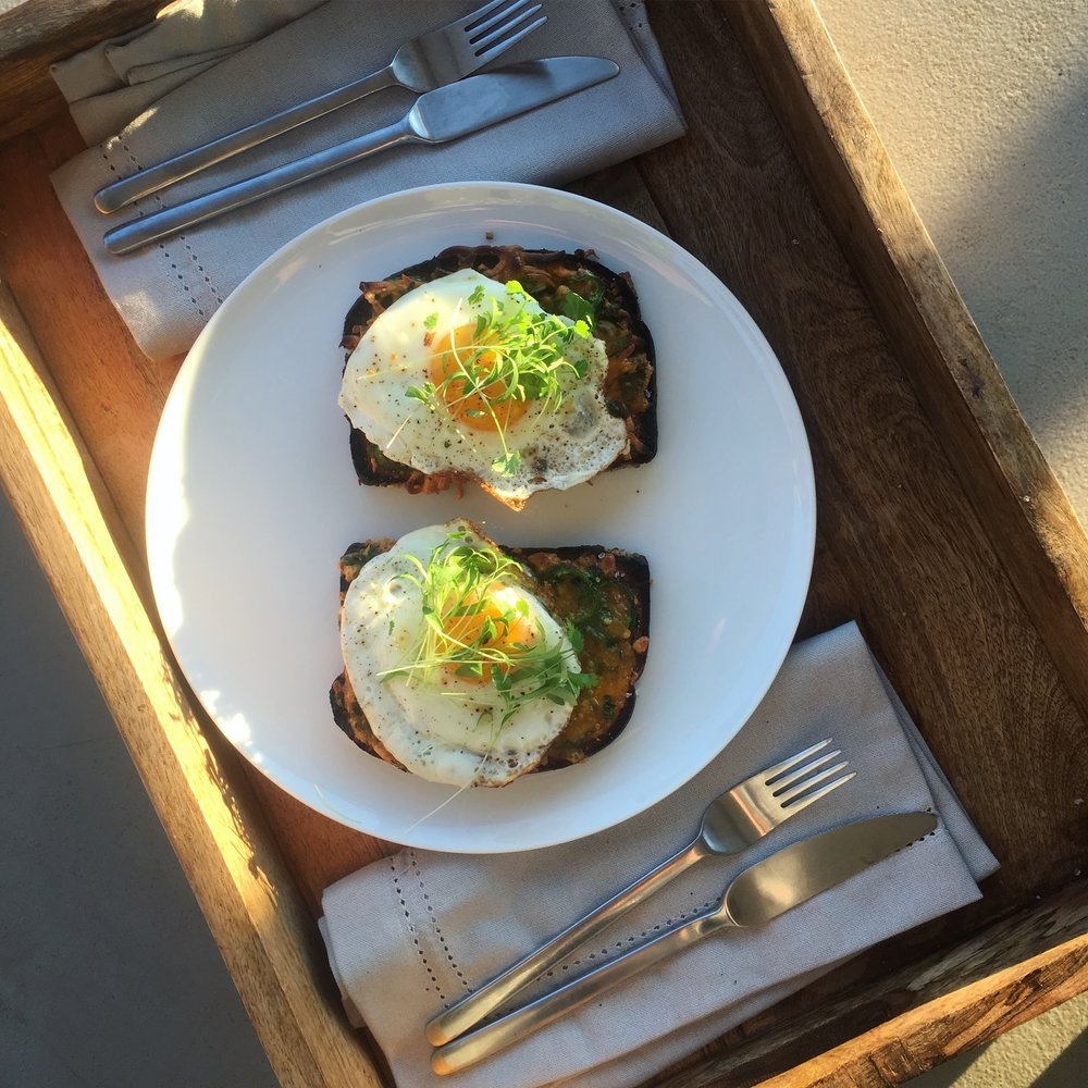 Cilantro microgreens make the perfect garnish for a simple farm breakfast. Photo: Mary Ackley (@littlewildthingsfarm)