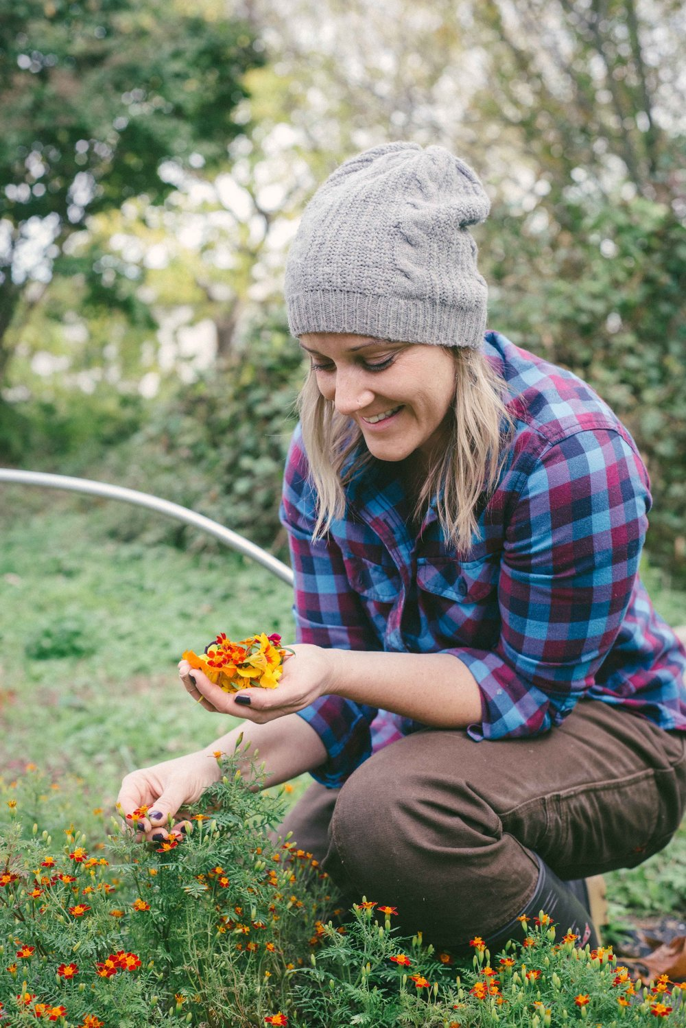 Mary, Founder (Right) harvesting gem marigolds at our outdoor plot in the Edgewood neighborhood of Washington D.C. Photo: Amber Breitenberg
