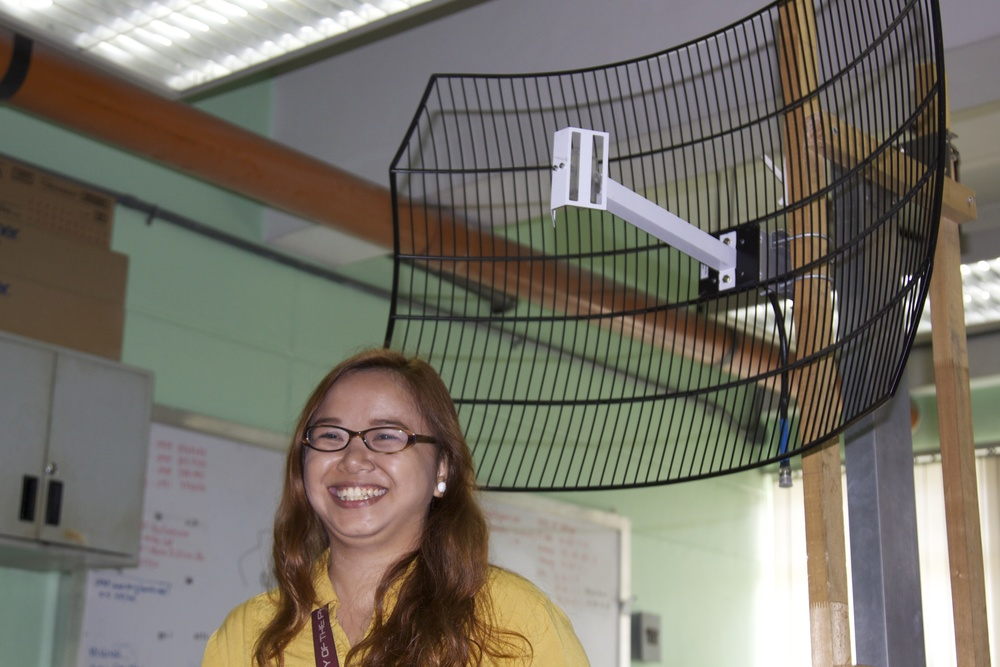 UP Engineering Masters student Theresa Cunanan with the antennae she built for CloudTop. This antennae can send wireless internet to schools up to 10km away from the source.