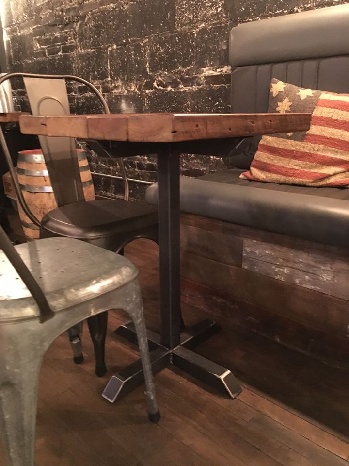 Custom reclaimed wood and steel pedestal pub table at Bitter Pops, Chicago.