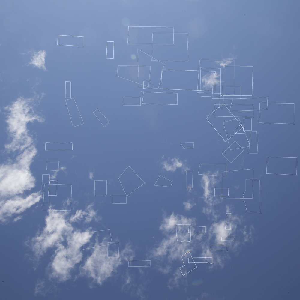 Every single vacant lot in the Reynoldstown neighborhood on Atlanta's east side is diagramed on top of a photograph of the sky above the city center.