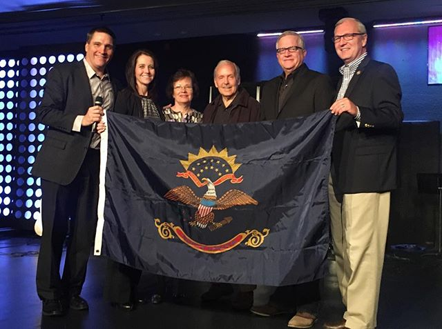 What a honor it was today to present the President of the Foursquare denomination, Glenn Burris Jr, with a North Dakota state flag! The flag was presented by our Congressman Kevin Cramer, our Founding Pastor Larry Jahnke and wife Karen, and our Senior Pastor Kurt Chaffee and wife Lisa. Glenn is sharing a great message with us this morning about 'Leading with clarity in a world of chaos.' Join us at 10:30 or Noon! #newsongbismarck #wearefoursquare