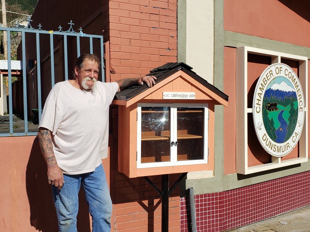 """Council Member and Rotarian """"Big Dave"""" just installed Dunsmuir's first Little Free Library 4/17/19."""