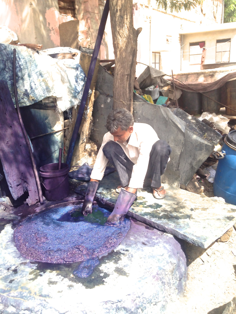 The 12-foot deep in-ground indigo vat was guarded for hours by this man, carefully lowering our mud printed fabrics below the bubbly surface so not to disturb the delicate balance of the vat.