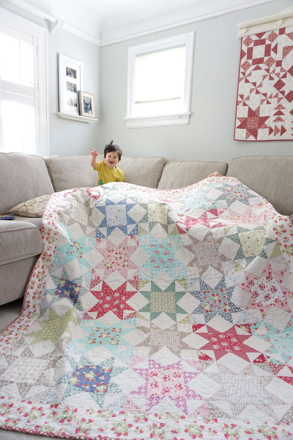 Such a sweet photo of Jera's little boy and La Conner Stars by Jera Brandvig of Quilting in The Rain for Lecien Fabrics