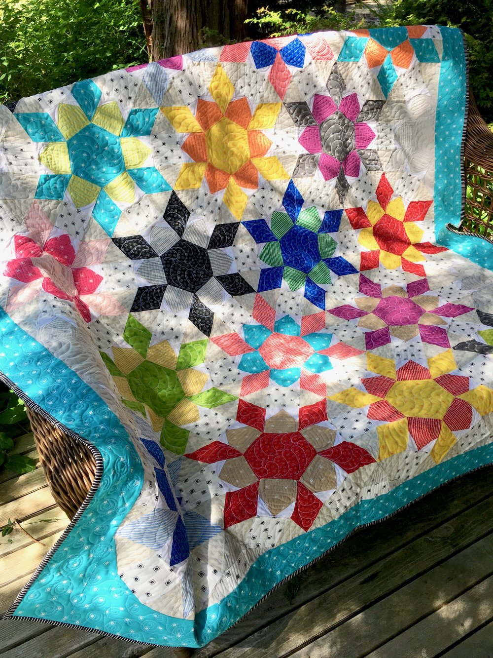 "Free Pattern ""Fiesta Time Flowers Quilt"" designed by Emily Breclaw"
