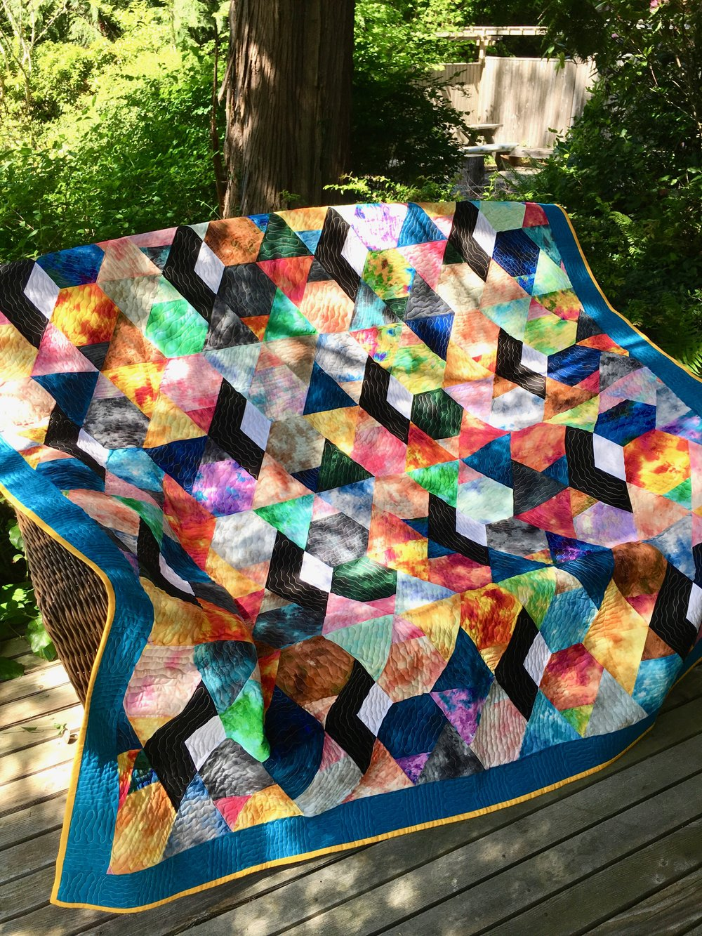 Sunny Splash Stained Glass Quilt designed, created, & quilted by Emily Breclaw