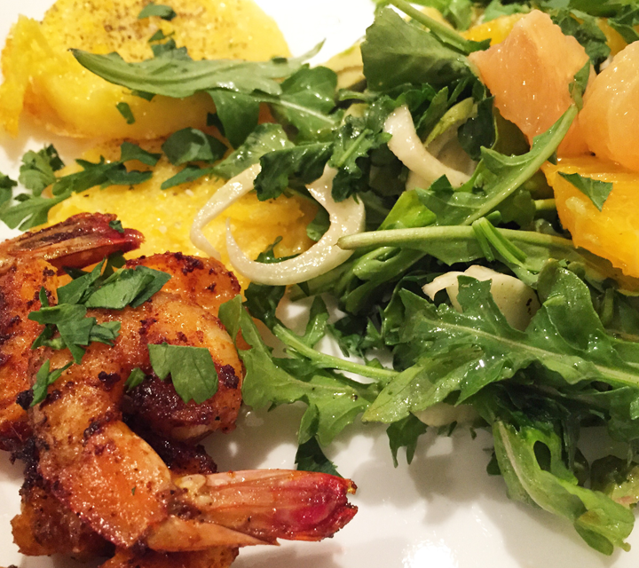 Spicy shrimp shown with an arugula fennel salad with citrus, and sautéed firm polenta