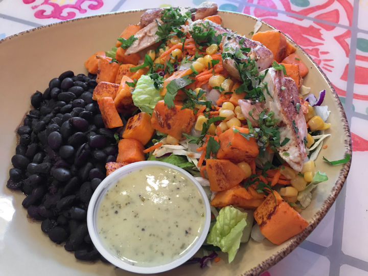 KB's salad with grilled Mahi, grilled yams, black beans, guacamole, cabbage, carrot, corn, cilantro, onion, romaine, spinach and cilantro-lime vinaigrette. All for $8.99.