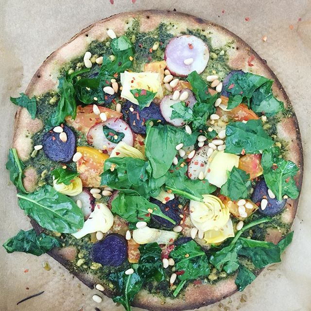 ✧dreaming✧ of last night's veggie loaded pizza✨🍕✨ . AND Yes, living a healthy lifestyle includes pizza. Home cooked pizza that is... On a paleo x gluten + flour free crust with homemade pesto, LOADS of veggies {artichoke hearts, a FM heirloom tomato, wilted spinach, thinly sliced potatoes}, and topped with pine nuts, red chili flakes + nutritional yeast #fitbrittnutrition