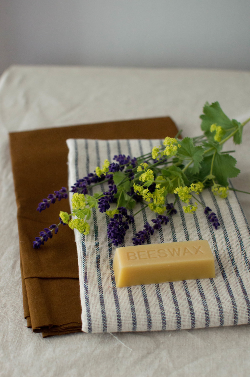 Beeswax Cotton Wraps  -  What you need: 1 stick of beeswax 100% cotton fabric cut to a variety of sizesbaking tray greaseproof paperpaintbrushgrater