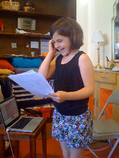 TMWFI-student-reading-her-work-out-loud2.jpg