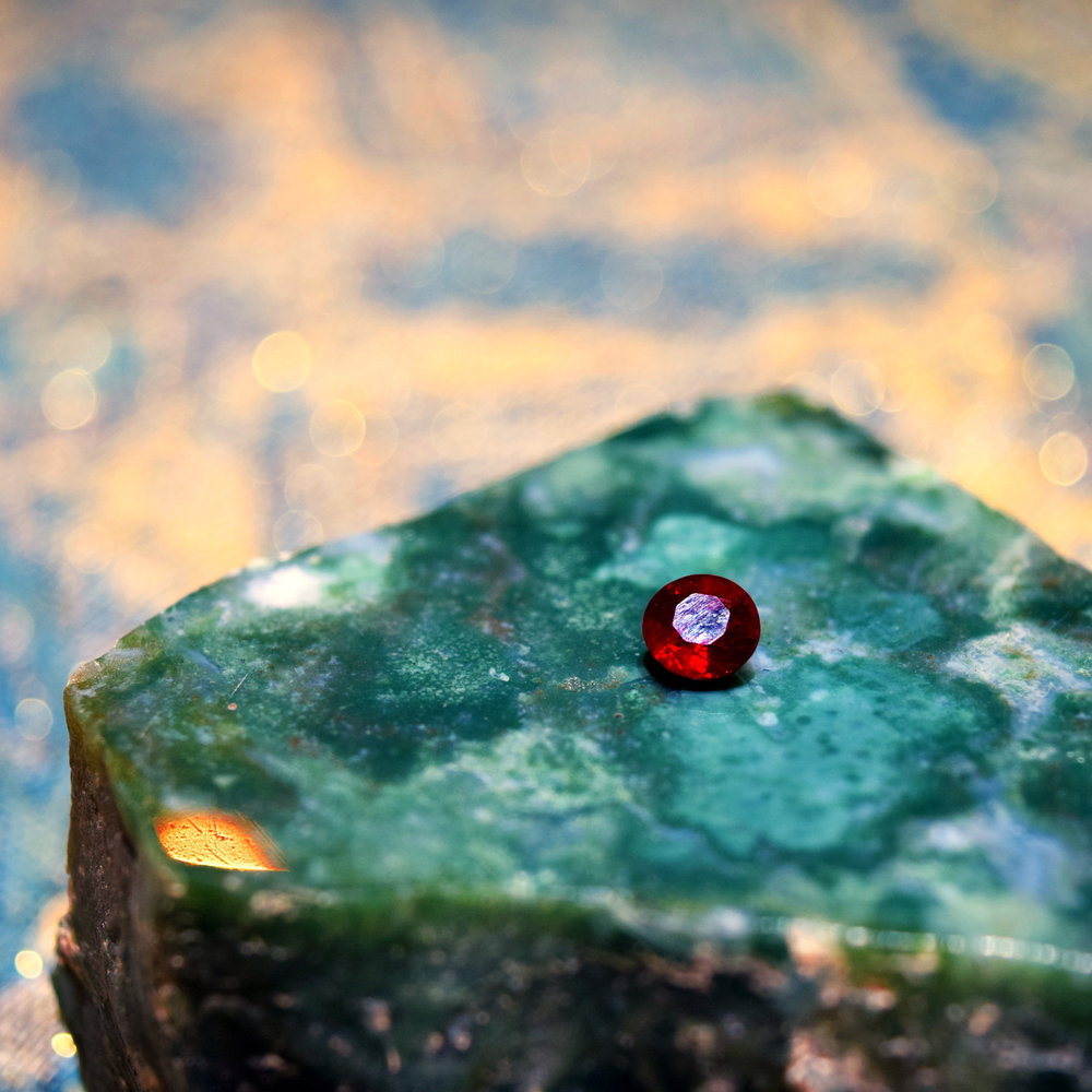 Brilliant ruby on a green stone