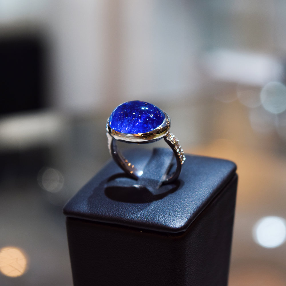 Cabochon cut tanzanite in white gold ring