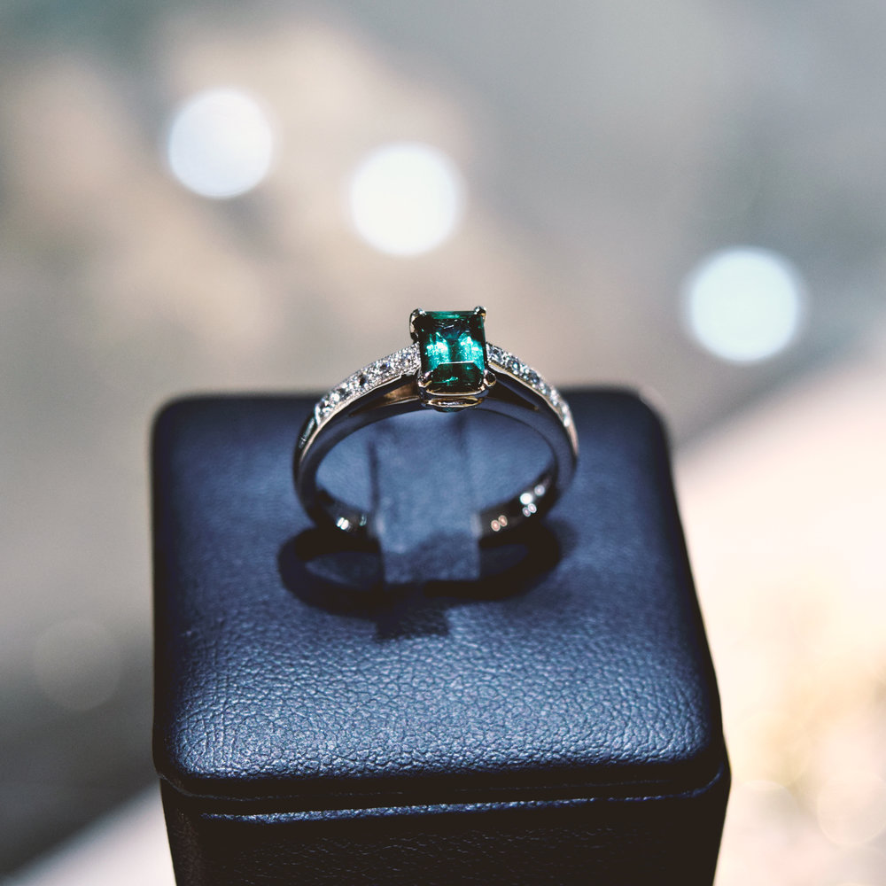 Green tourmaline in palladium ring with diamonds