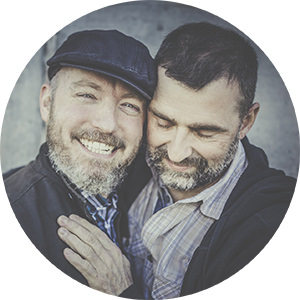 Gay couple laughing during their engagement photos in London