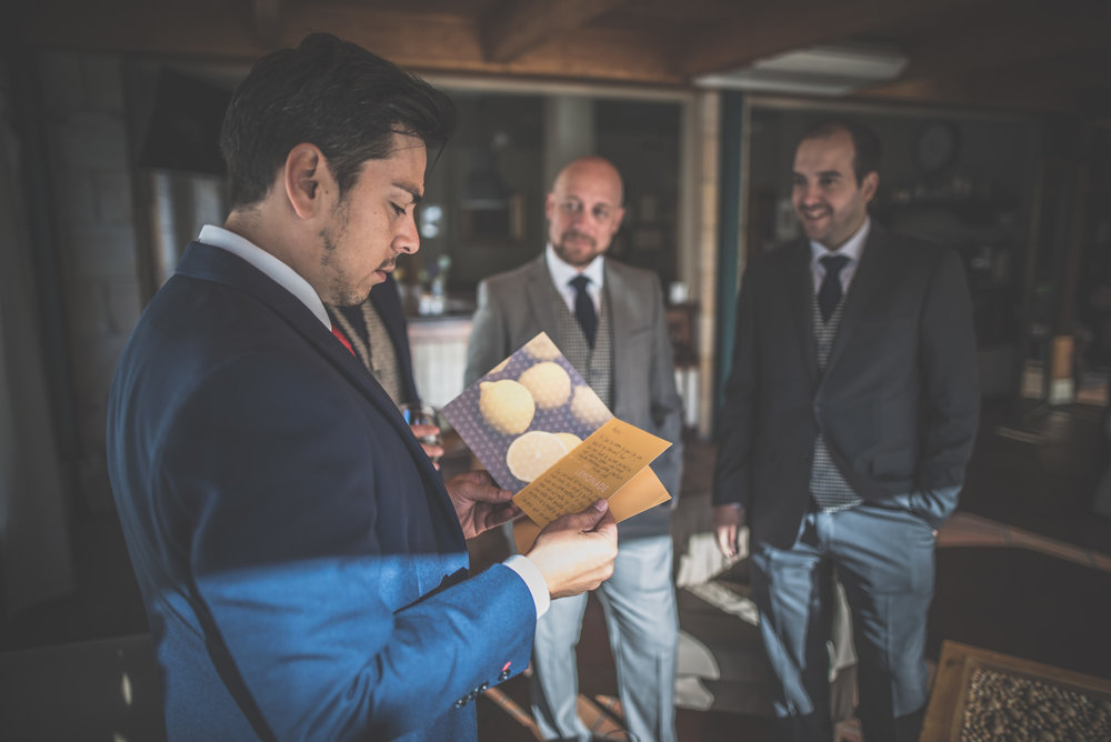 groom reading card from the bride before the wedding
