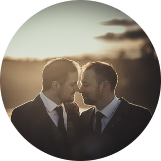 Wedding photo of a gay couple during their same-sex wedding in Blenheim Palace, Oxforshire