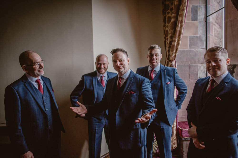 Groom, father of the bride, ushers and groomsmen getting ready for the ceremony at Peckforton castle