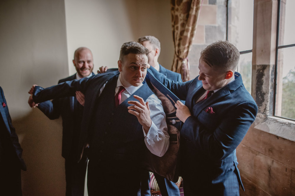 Groomsmen getting ready at Peckforton Castle