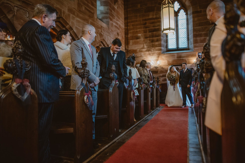 Religious wedding ceremony in Peckforton Castle