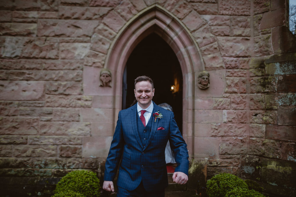 Groom after the wedding ceremony in Peckforton Castle