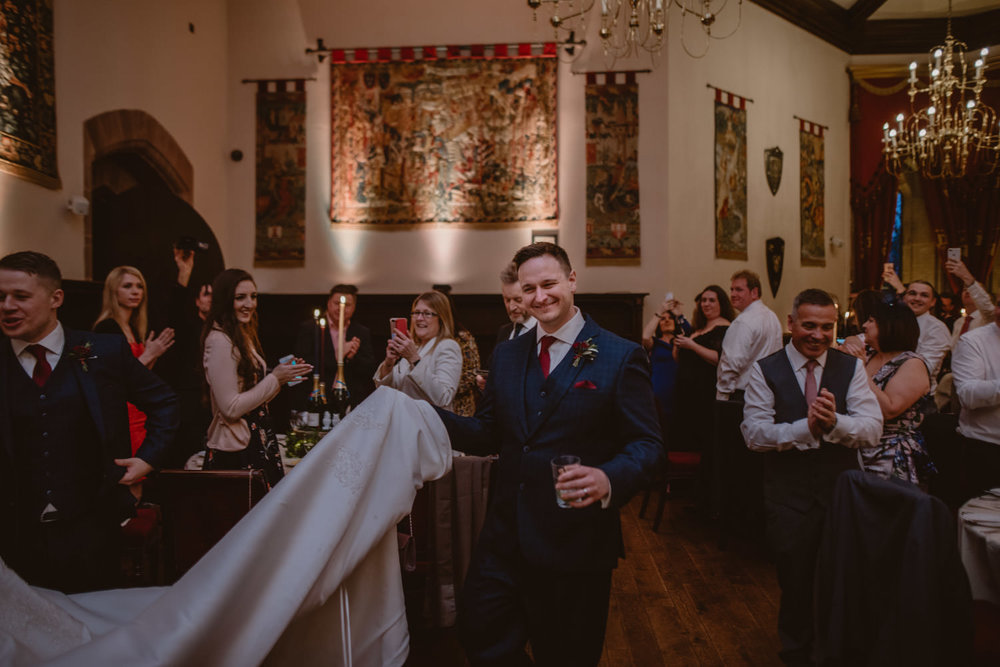 Groom at the wedding reception in Peckforton Castle