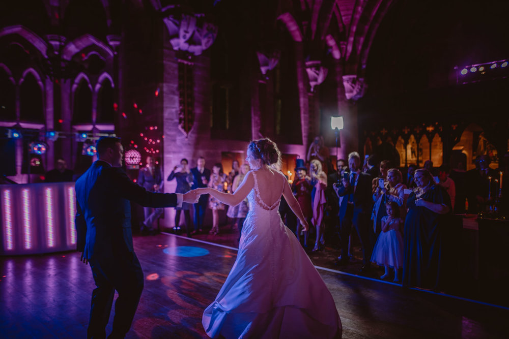 Bride and groom dancing their first dance in Peckforton Castle
