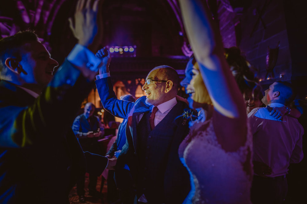 Guests having fun during then wedding party in Peckforton Castle