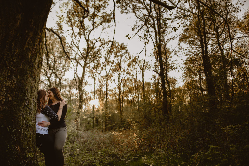 same-sex couple engagement photos in Savernake Forest