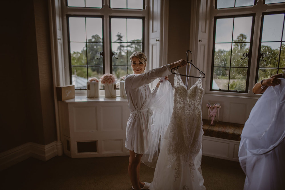 Bride getting ready at the Seymour room in The Elvetham Hotel Wedding Venue