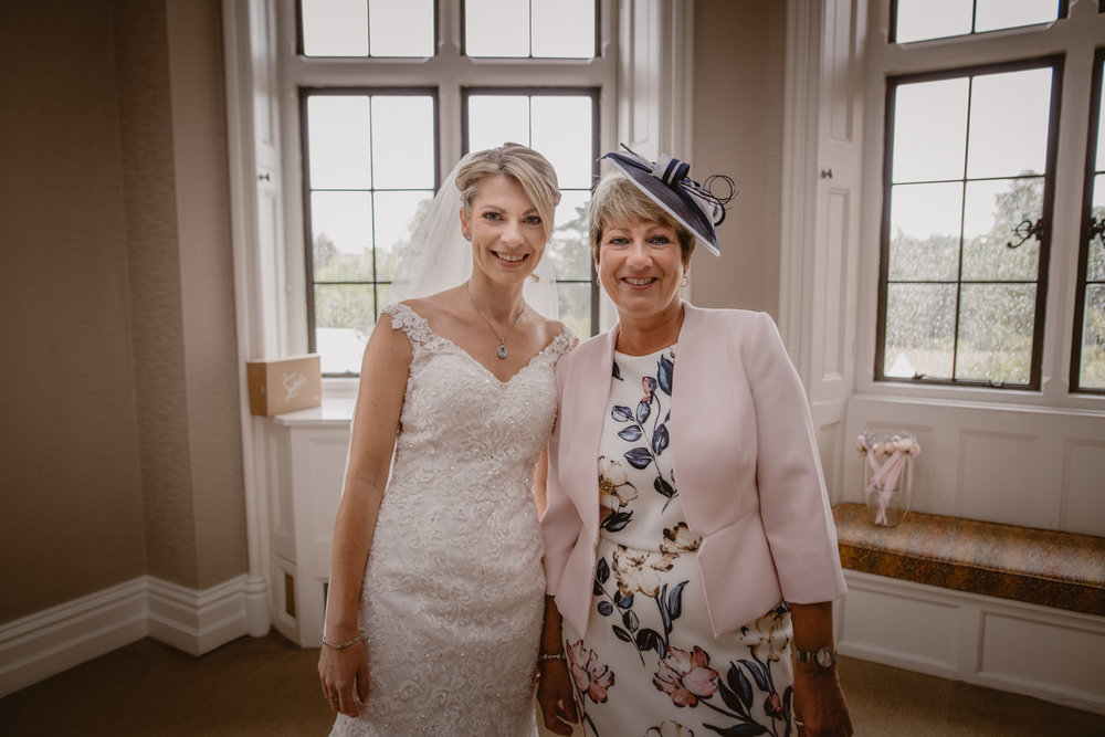 Portrait of the bride and mother of the bride in The Elvetham Hotel wedding venue