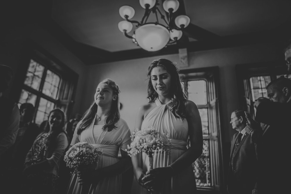 Bridesmaids walking the aisle at The Elvetham Hotel in Hampshire