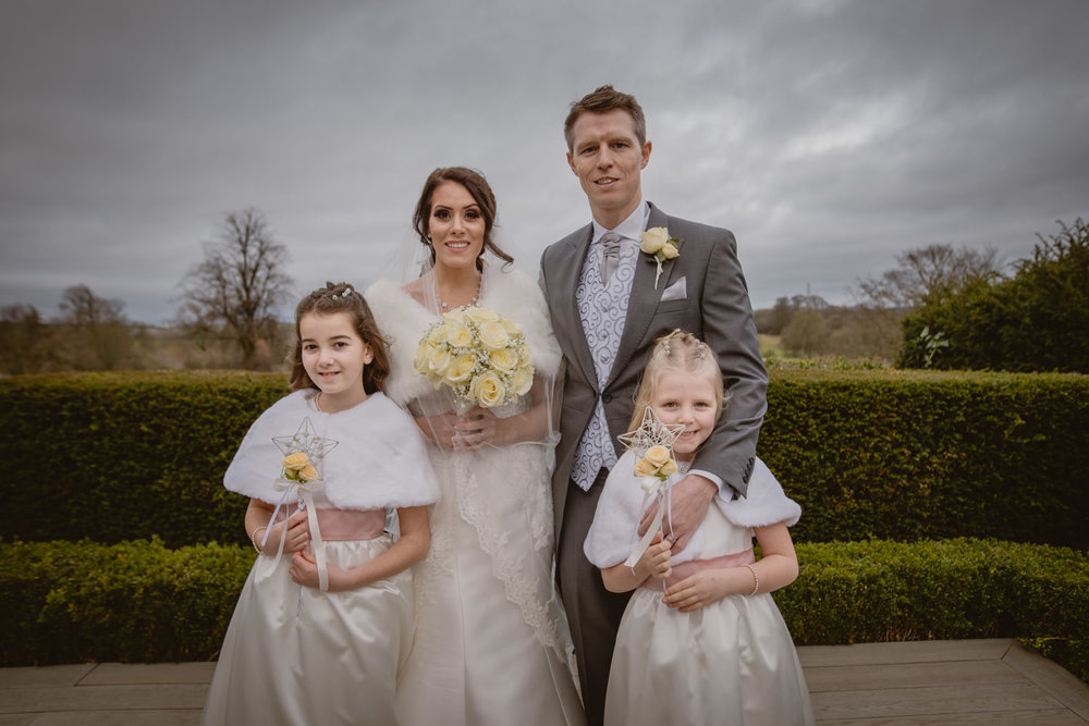 Bride, groom and daughters photo