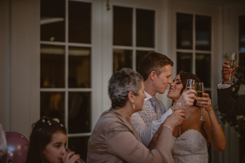 Bride and Groom toast during their wedding reception