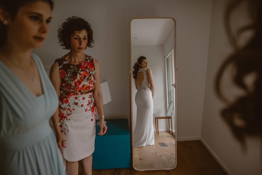 bride seeing herself in a mirror