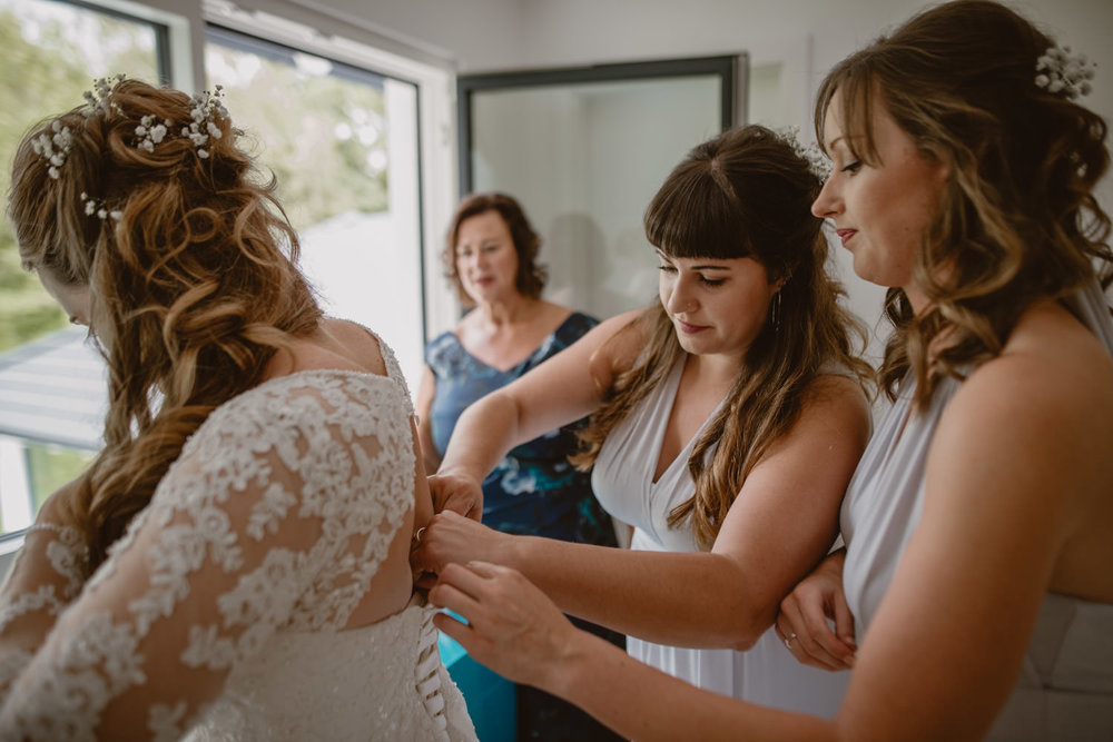 Bridesmaids and bride during the wedding getting ready