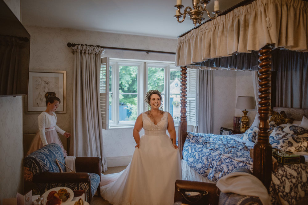 Bride with her dress on before the ceremony