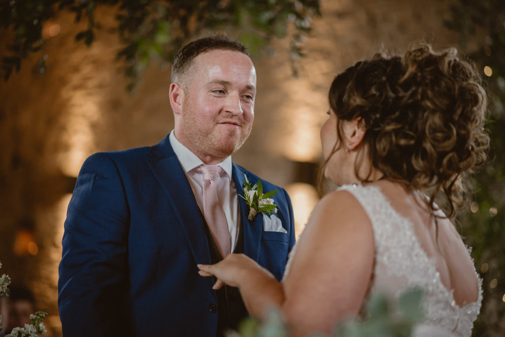 Groom and bride getting married at Cripps Barn