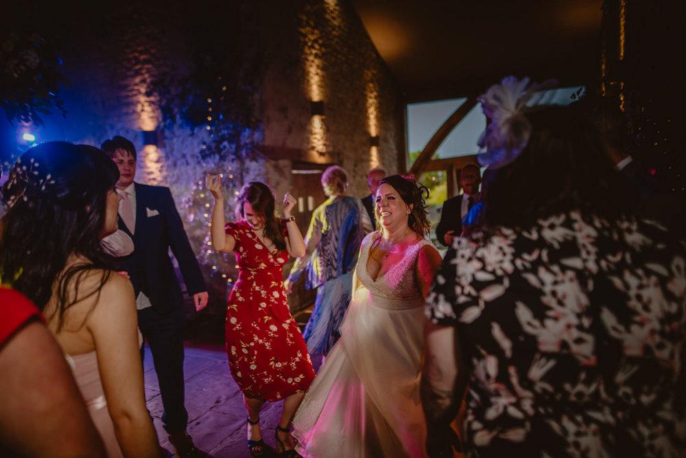 Bride dancing Cripps Barn Gloucestershire