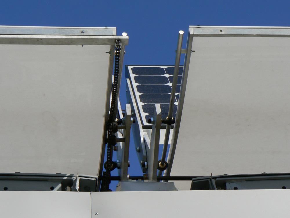 solar decathlon-solar panels and adjustable rack on roof.jpg