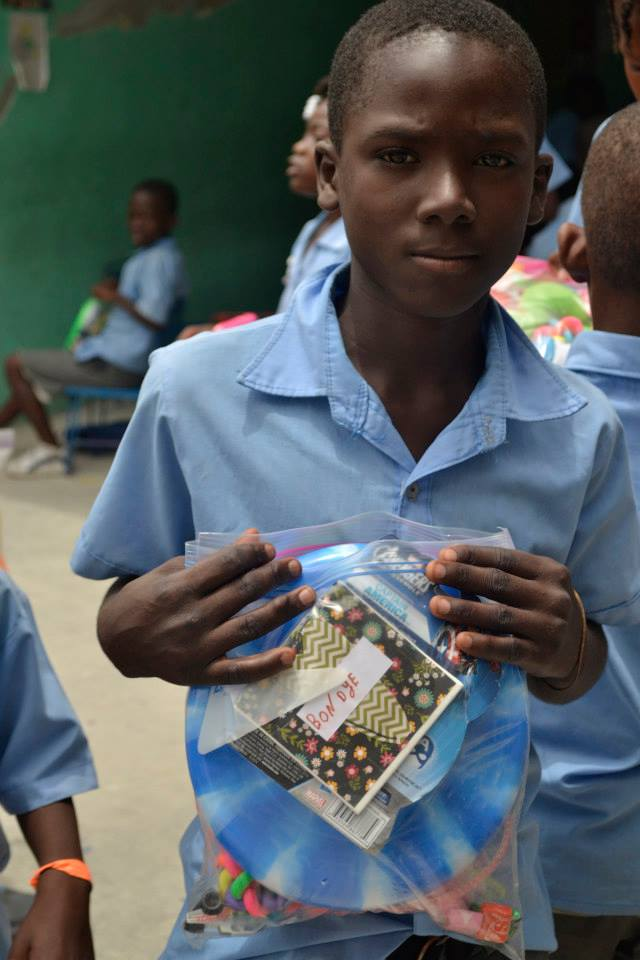 Emerson with gifts from his sponsor