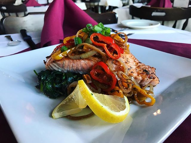 In house filleted Scottish Salmon seasoned and seared over sautéed garlic spinach and topped with roasted shallots and sweet bell peppers