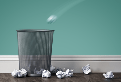 trash-bin-along-teal-wall-with-crumpled-paper (1).png