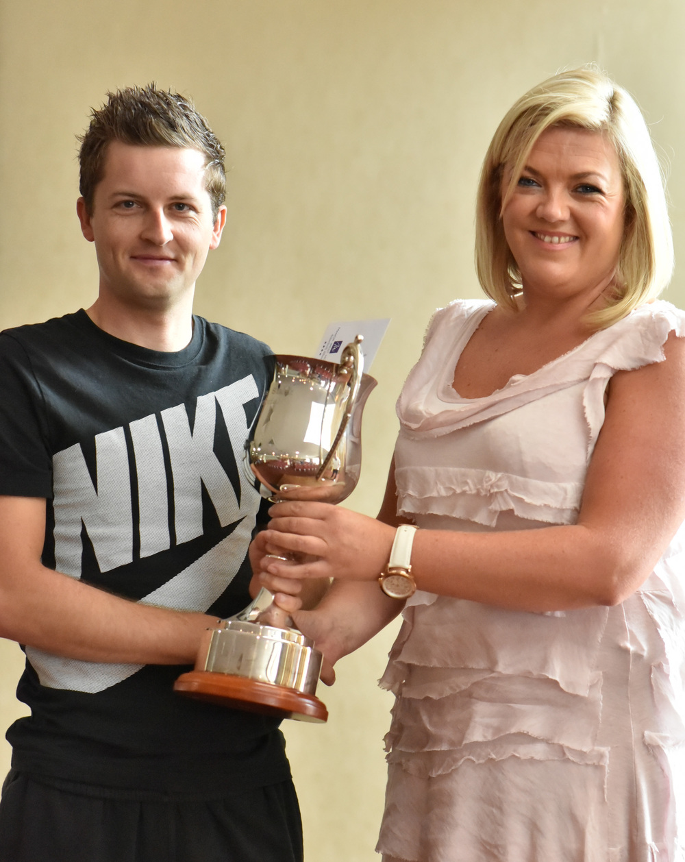 Mark Dowling being presented with the Michael de Staic Memorial cup by Michael's daughter Orla