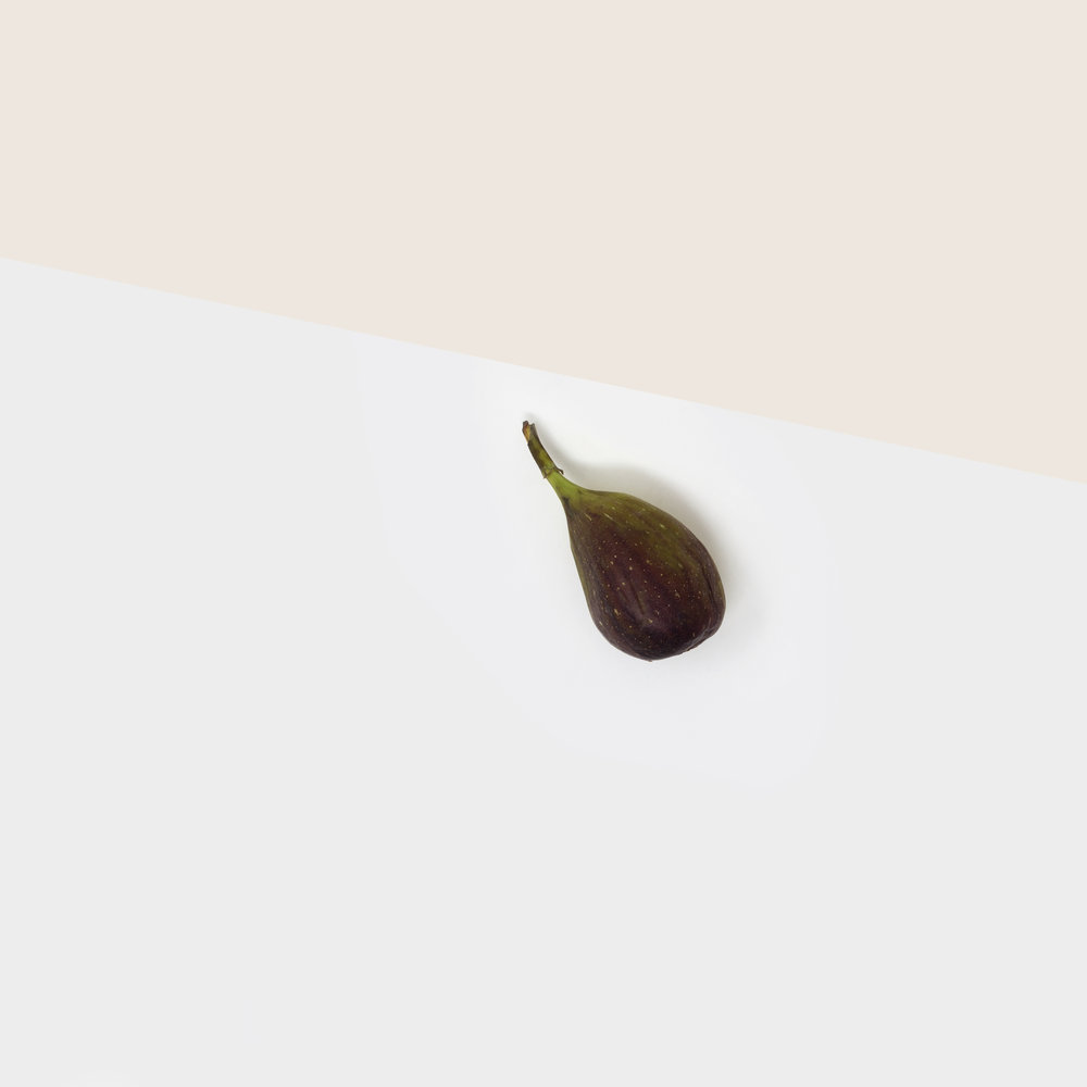 A simple, minimalist, contemporary, fine art photograph of a fig