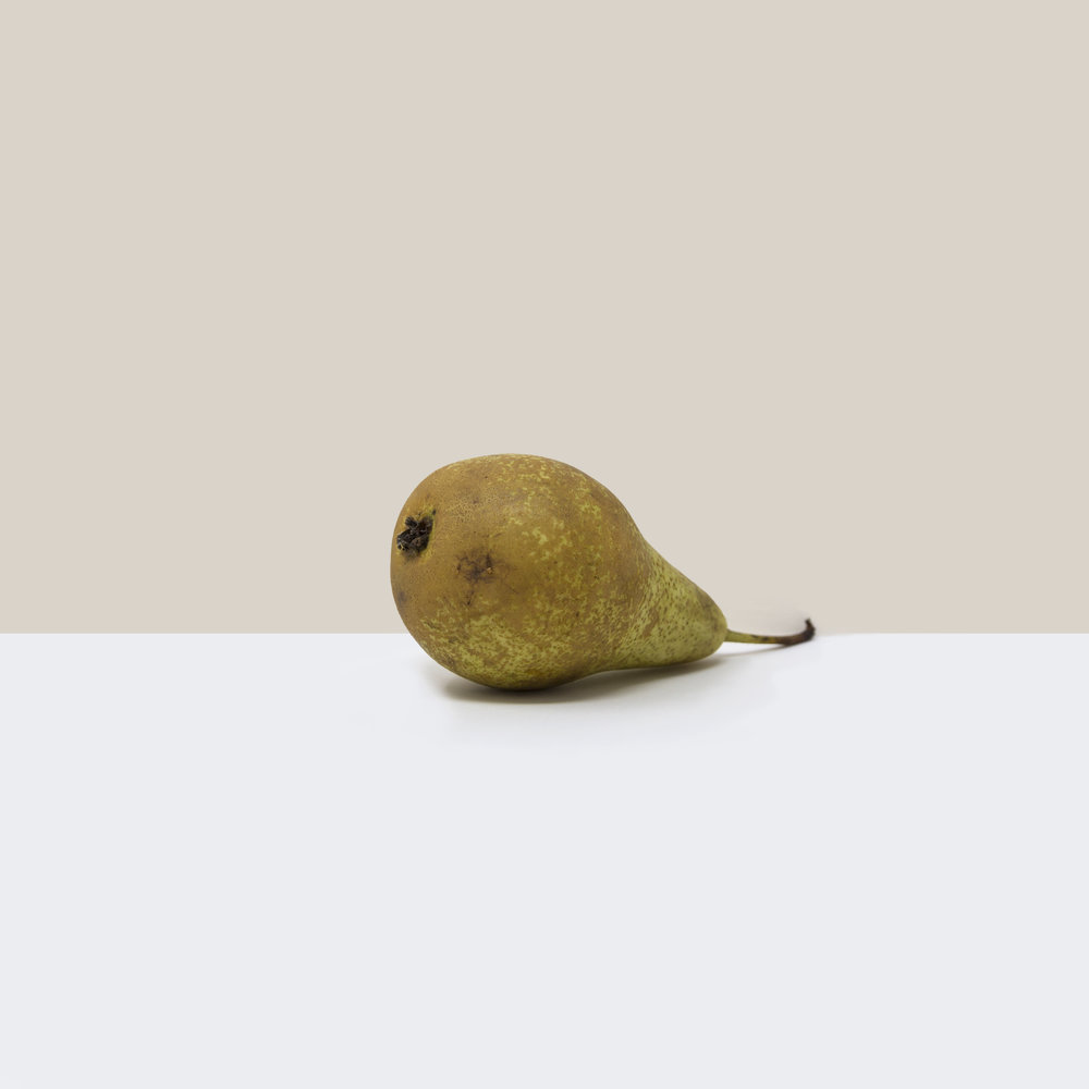 A simple, minimalist, contemporary, fine art photograph of a pear