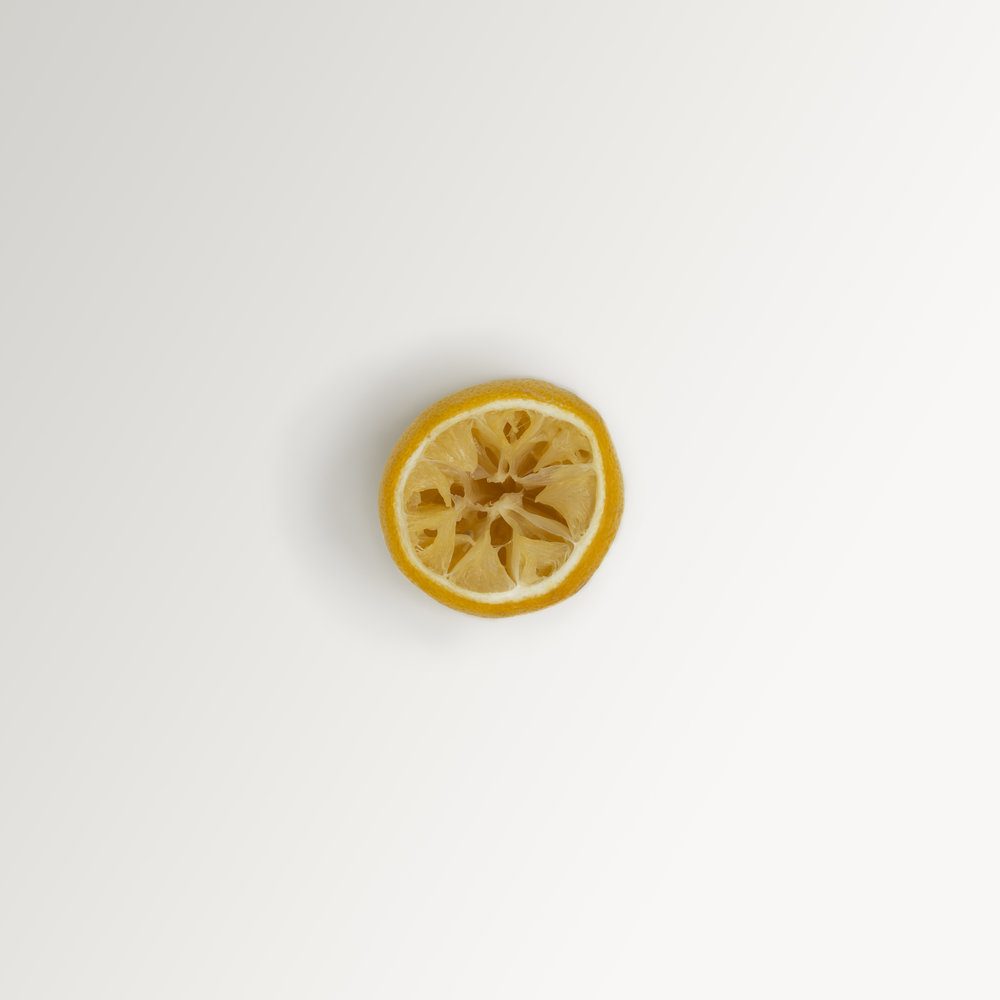 A simple, minimalist, contemporary, fine art photograph of a lemon