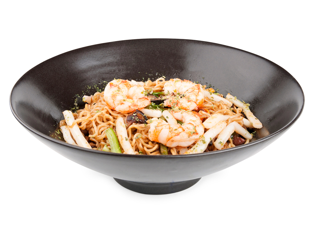 Vegetable and seafood yakisoba.  Delicius rice noodles sautéed with fresh vegetables, prawns and squid.